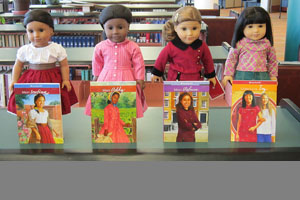 4 American Girl Dolls with books