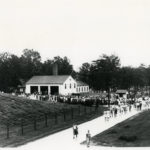 """Workers arriving to Arlington Hall Station, 1940s. Historic American Buildings Survey – Arlington Hall: Photographs Written Historical and Descriptive Data – """"In January 1944, a directive ordered an increase in the size of the Arlington Hall Station staff. An additional 700 enlisted women, 200 officers, and 2, 275 civilian employees were assigned to the facility. In anticipation of this increase, plans were prepared for the construction of thirteen centrally-heated, mobilization-type barracks, a fourteen-bed dispensary, a 620-seat auditorium and theater, a troop administration building, a new motor repair shop, a new mess hall, a new post exchange building, a new Post engineer office and shop, a recreation building, a 9,000 square-foot warehouse, and additional cafeteria facilities. No new office space was required since most of the new personnel were to be assigned to graveyard or swing shifts."""""""