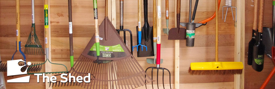 Hanging garden tools with The Shed logo