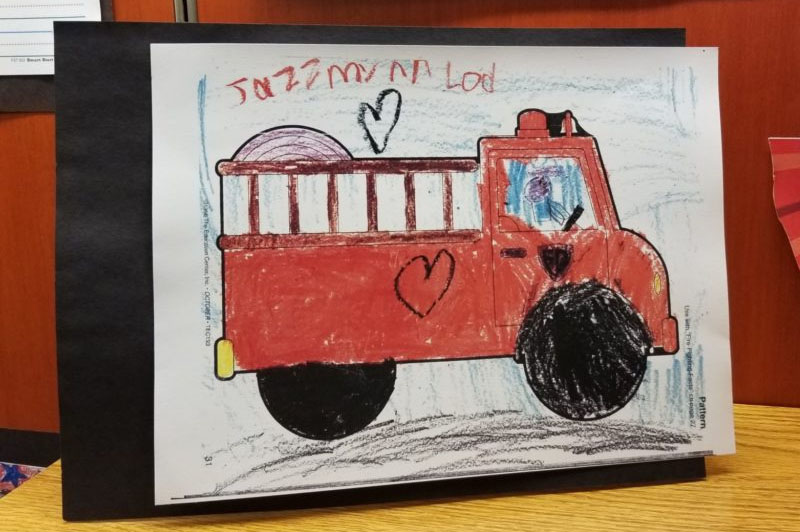 drawing of a firetruck with a heart