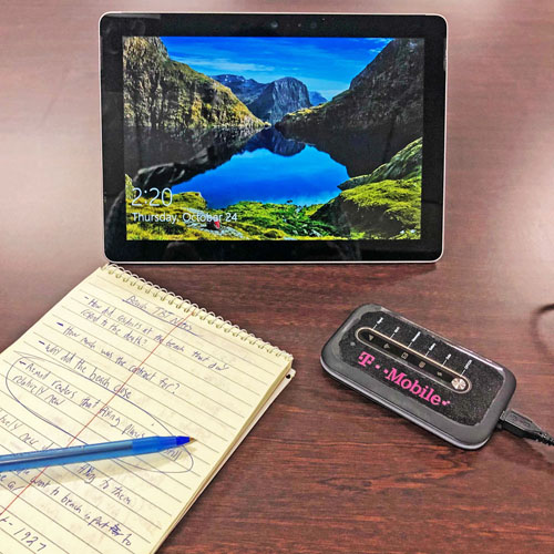 photo of a tablet computer and a wireless hotspot