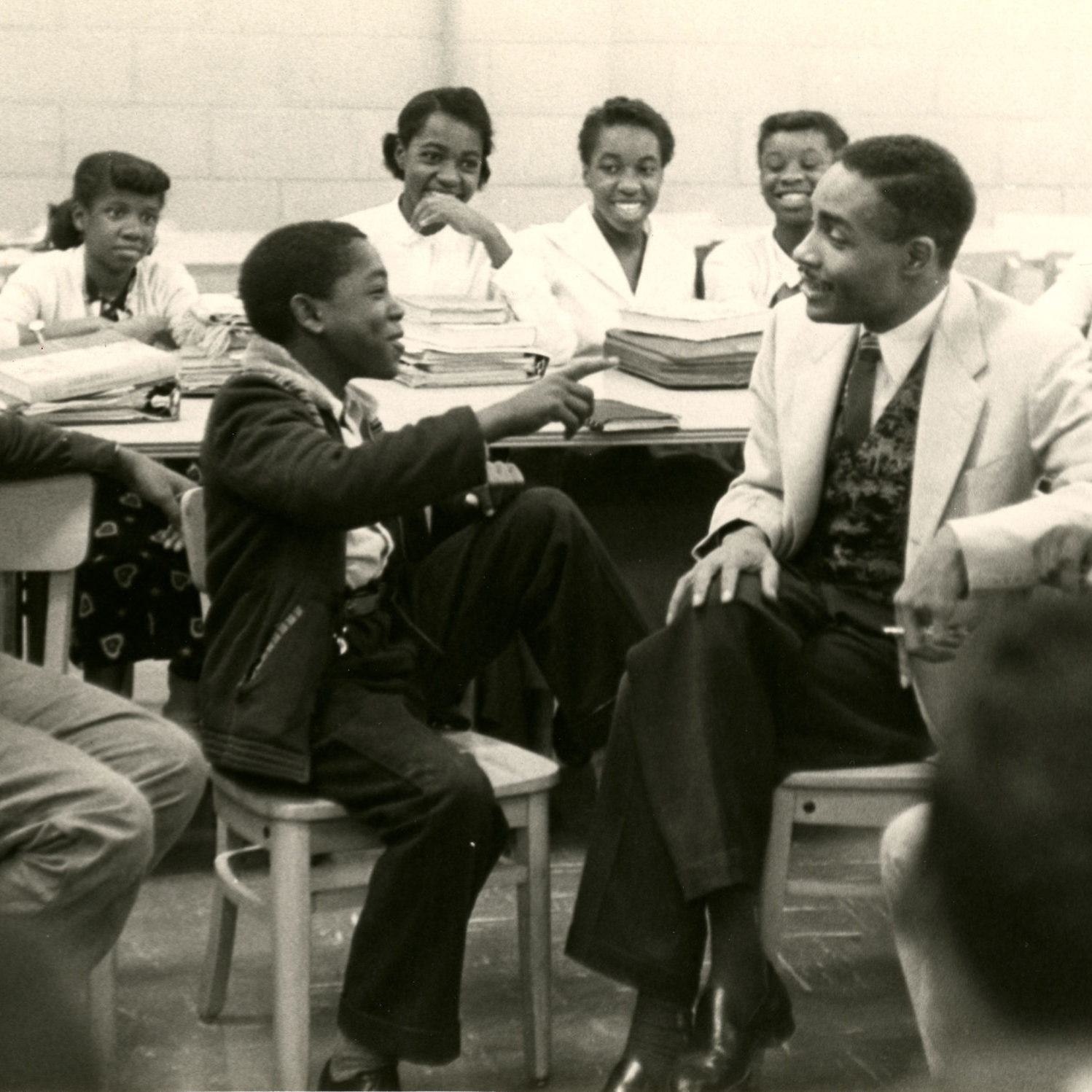 George Richardson talking with several younger Hoffman-Boston students.