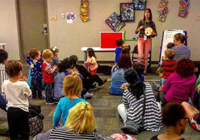 Emily leads an Early Literacy Storytime with toddlers and caregivers
