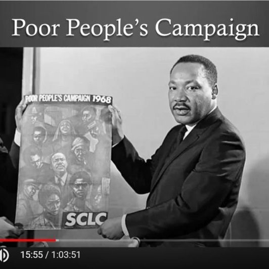 """MLK holds banner under the words """"Poor People's Campaign"""""""