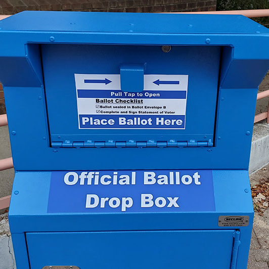 Official Ballot Drop Box is blue and has a door like a mailbox.
