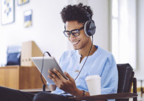 Man listening to an audiobook on tablet