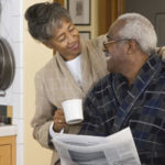 Senior African American couple at breakfast table